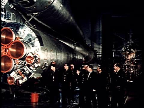 yuri gagarin and other future spacemen stand in front of the vostok 1 rocket - propaganda bildbanksvideor och videomaterial från bakom kulisserna