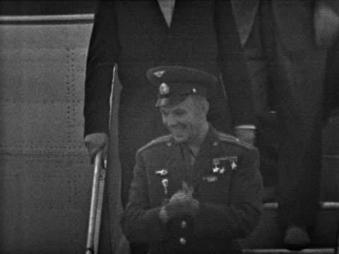 Yuri Gagarin disembarks a plane at London airport at the start of his visit to the UK