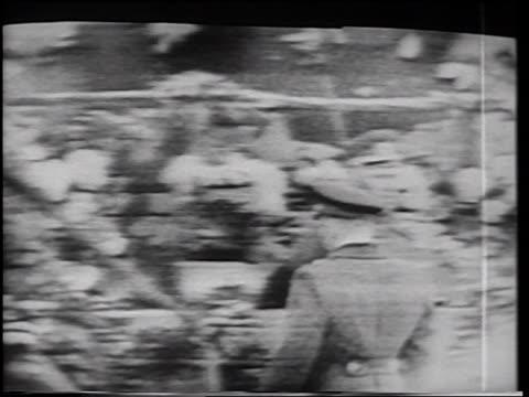 Yuri Gagarin in uniform approaching Nikita Khrushchev on platform after flight / on TV