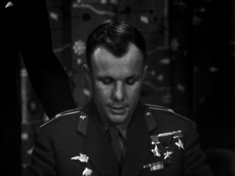 Yuri Gagarin makes a speech with the help of a translator at the start of his visit to the UK