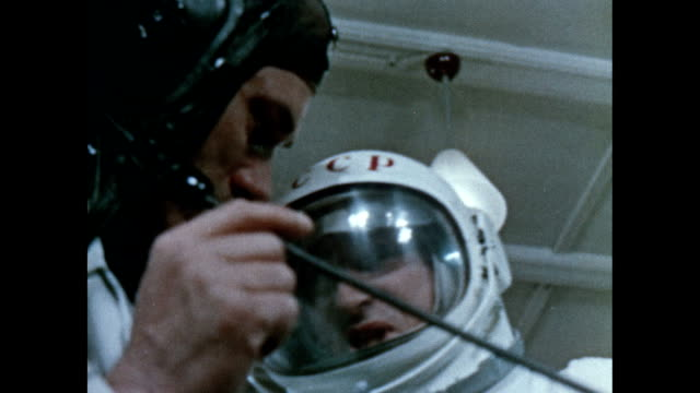 Yuri Gagarin observes Pavel Belyayev and Alexei Leonov training for Voskhod 2Y
