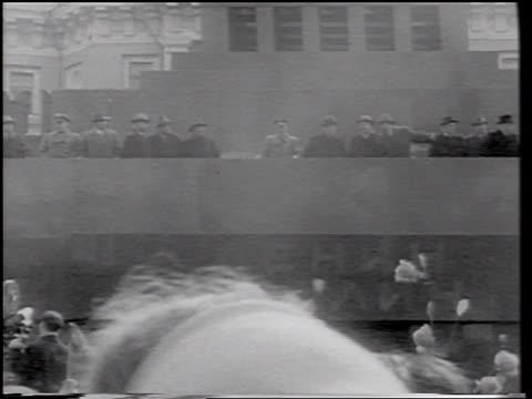 Yuri Gagarin on balcony waving / crowd waving in foreground / Moscow