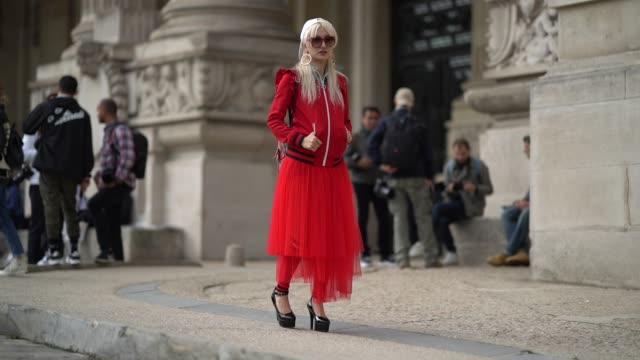 yuri nakagawa darayunya wears a red dress, a red jacket with ruffle, a gucci backpack, a balenciaga white cap, outside margiela, during paris fashion... - berretto da baseball video stock e b–roll