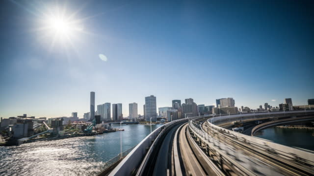 T/L WS POV Yurikamome Train Riding Through the Rainbow Bridge / Tokyo, Japan