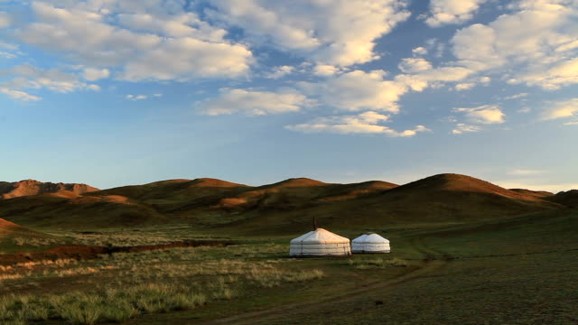 Yurts in the desert at sunset. Mongolian steppe.