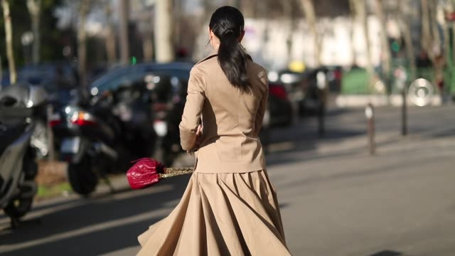 yuwei zhangzou is seen wearing beige trench jacket, skirt, button shirt with tie, red bag outside dior during paris fashion week - haute couture... - skirt stock videos & royalty-free footage