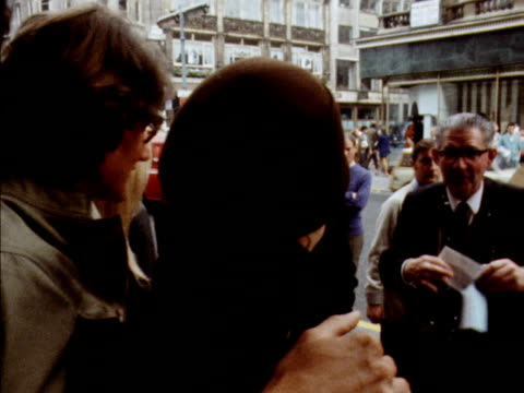 vidéos et rushes de yves st laurent and two female models pose for photographers outside his new shop on new bond street 1969 - 1960 1969