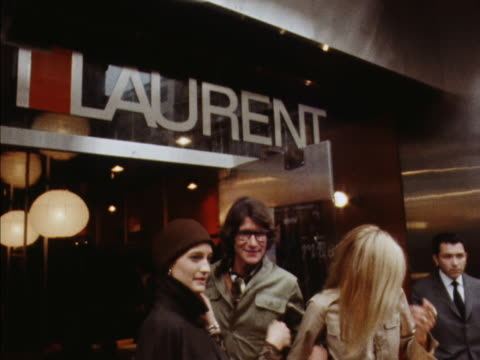 yves st laurent and two female models posing for photographers outside his new shop on new bond street. 1969. - saint laurent stock videos & royalty-free footage