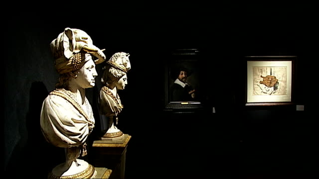 yves st laurent collection woman looking at wall with 3 paintings from left top right 'portrait d'alfred et elisabeth dedreux' by theodore gericault... - livre stock videos & royalty-free footage