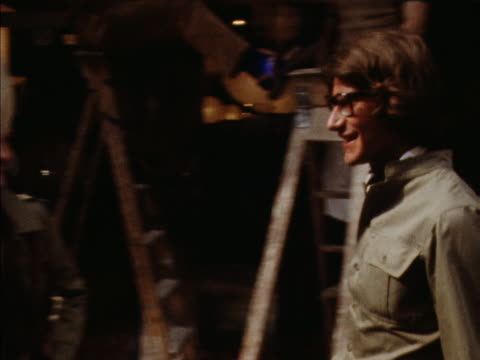 vidéos et rushes de yves st laurent walks up to two women modelling khaki/safari style clothes outside of his new shop on new bond street 1969 - 1960 1969