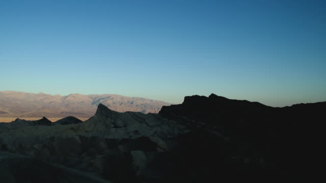 stockvideo's en b-roll-footage met t/l ws zabriskie point in death valley from dusk to starry night lit by moonlight / inyo county, california, usa - zabriskie point
