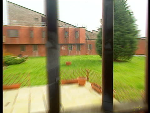 man jailed lnn england surrey feltham int buildings at feltham young offenders institute pull out seen thru barred window la corridor with bars all... - public building stock videos and b-roll footage