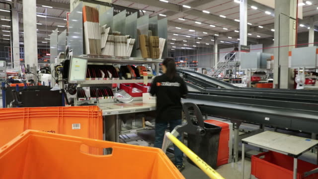 zalando se online shopping logistics and fulfillment center in erfurt germany on thursday august 15 2019 - online shopping stock videos & royalty-free footage