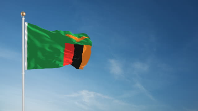 4k zambia flag - loopable - zambia stock videos & royalty-free footage