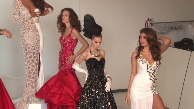 zana krasniqi, marigona dragusha, chloe mortaud and other former miss universe beauty queens at the donald trump poses with former miss universe... - ミスコン受賞者点の映像素材/bロール