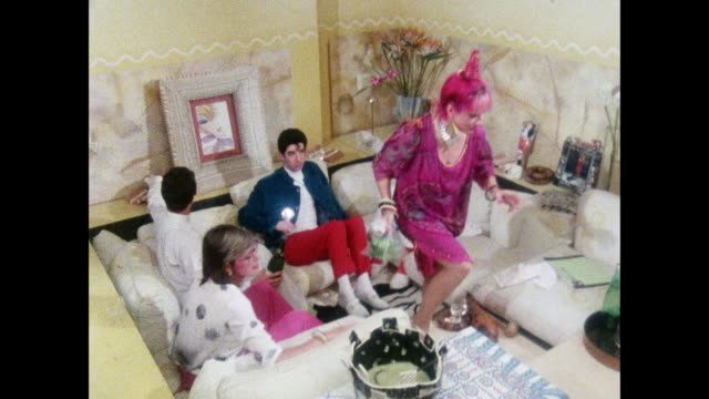 zandra rhodes celebrates with friends / uk / zandra rhodes hosts a party / man pops cork of champagne bottle / man pours champagne - champagne stock videos & royalty-free footage