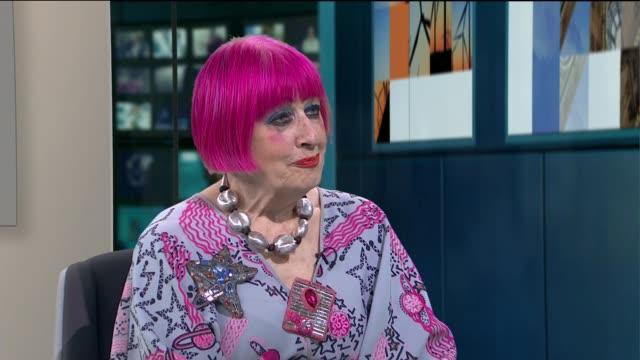 gir int dame zandra rhodes live studio interview sot on meghan markle's wedding dress - hochzeitskleid stock-videos und b-roll-filmmaterial