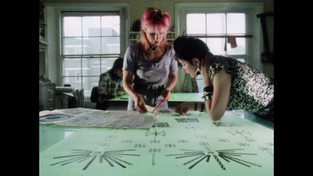 zandra rhodes works on a light table in a fashion design studio / uk / women look at drawings / zandra rhodes points to side / drawing over light... - design studio stock videos & royalty-free footage