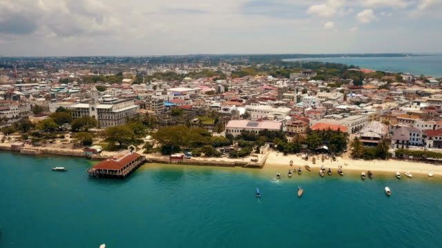 zanzibar stone town: aerial shot with old fort and historical monuments - zanzibar archipelago stock videos & royalty-free footage