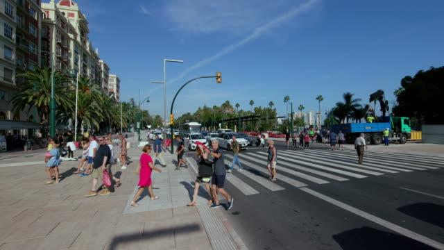 zebra crossing on plaza de la marina, malaga, andalusia, spain - push scooter stock videos & royalty-free footage