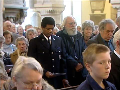stockvideo's en b-roll-footage met church memorial service held congregation singing a hymn sot members of the congregation in silent prayer pan - zeebrugge