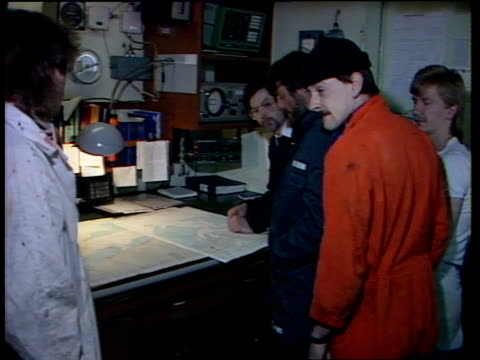 stockvideo's en b-roll-footage met rescue coordinator submits report belgium zeebrugge harbour ext ms 'the duke of anglia' container ship on approach to harbour tms officers on bridge... - ramp veerboot zeebrugge 1987