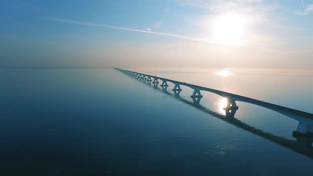zeelandbrug during sunrise - air to air shot stock videos & royalty-free footage