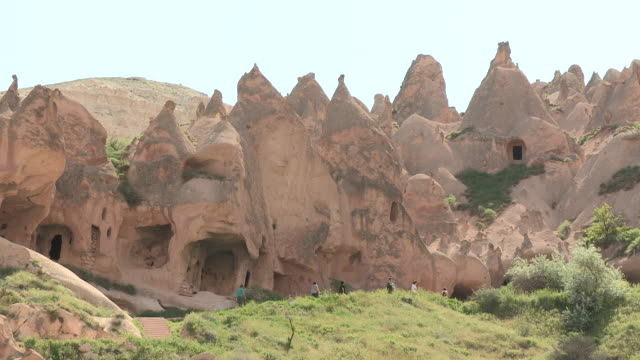 zelve tourists, cappadocia, turkey - cliff dwelling stock videos & royalty-free footage