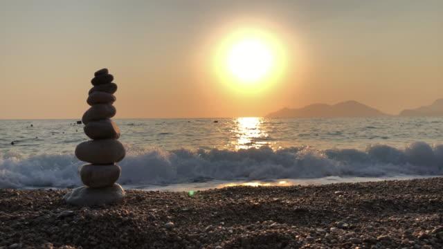 zen balancing pebbles, harmony and balance - lastone therapy stock videos & royalty-free footage