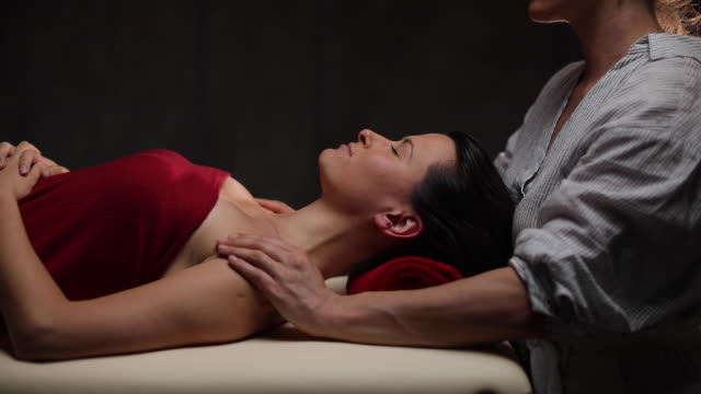 zen massage at spa center - massage table stock videos & royalty-free footage