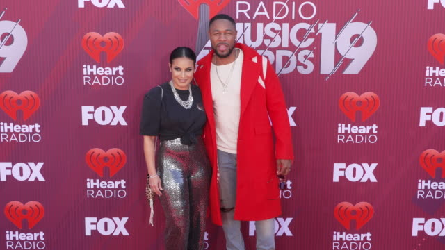 Zena Foster and Tank at the 2019 iHeartRadio Music Awards at Microsoft Theater on March 14 2019 in Los Angeles California
