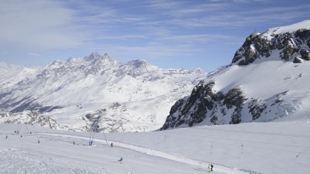 zermatt, skiers in plateau rosa, switzerland. - pennines stock videos and b-roll footage
