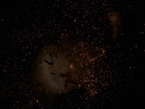 vídeos de stock, filmes e b-roll de zero gravity explosion with comets and sparks - zero gravity