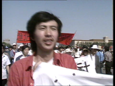 china beijing tiananmen sq students marching singing - tiananmen square stock videos & royalty-free footage