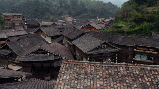 zhaoxing traditional dong town in guizhou china aerial view - village stock videos & royalty-free footage