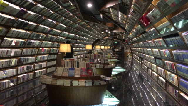 zhongshuge bookstore is a new cultural landmark of yangzhou the bookstore with mirrors and curves creating a mirage is designed to symbolize the... - jiangsu province stock videos & royalty-free footage