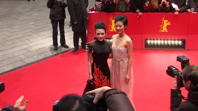 stockvideo's en b-roll-footage met zhou xun, fan hsiao shuan at flying swords of dragon gate premiere: 62nd international berlin film festival 2012 at berlinale palace on february 17,... - mei