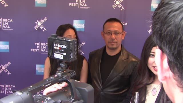 zhou yun and wen jiang at the 2011 tribeca film festival premiere of 'let the bullets fly' at new york ny - film premiere stock videos and b-roll footage