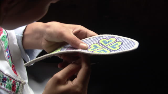 zhuang girl embroiders sole of shoe, ping'an village, guilin, guangxi zhuang - asian tribal culture stock videos and b-roll footage