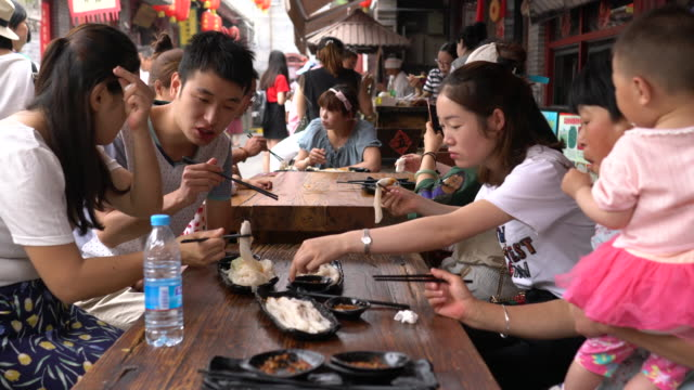 zichang pancake made of buckwheat is a local pasta popular in shaanci province originated from zichang county yongxing fang is an emerging gourmet... - chinese food stock videos & royalty-free footage