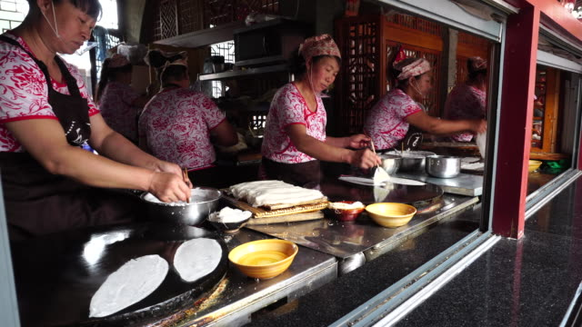 Zichang Pancake made of buckwheat is a local pasta popular in Shaanci Province originated from Zichang county Yongxing Fang is an emerging gourmet...