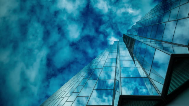zigzagged glass wall reflections - time lapse - office block exterior stock videos & royalty-free footage