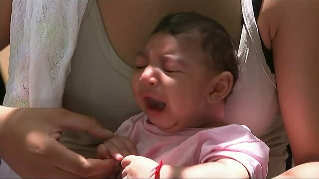 holidaymakers warned that disease is expected to spread to europe; t28011613 / 28.1.2016 brazil: recife: baby with microcephaly condition - virus zika video stock e b–roll
