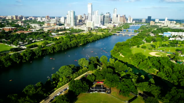 zilker park live music venue and town lake with austin texas downtown background - water sport stock videos and b-roll footage