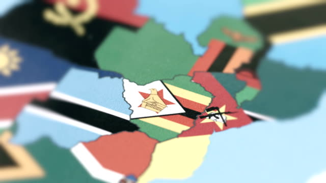 zimbabve borders with national flag on world map - harare stock videos and b-roll footage
