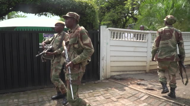 Zimbabwe army soldiers guarding one of Robert Mugabe's residences from demonstrators after a successful coup to remove him from power
