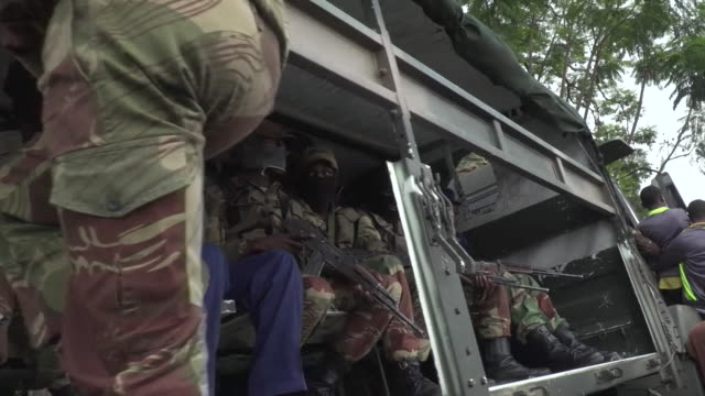 zimbabwe army soldiers in a truck in harare after the successful coup to remove president robert mugabe from power - harare stock videos and b-roll footage