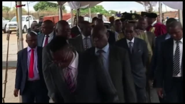 Zimbabwe President Robert Mugabe arriving to open a graduation ceremony days after a military coup