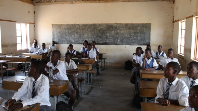 zimbabwe, school in a secluded area near chakari. - afrika stock-videos und b-roll-filmmaterial
