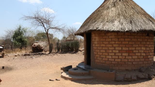 zimbabwe, secluded settlement near chakari. - repubblica dello zimbabwe video stock e b–roll